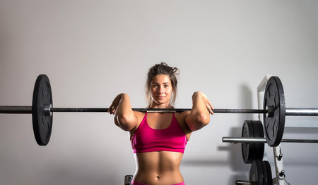 heavy weight: Young adult girl doing heavy weightlifting during cross fit exercise