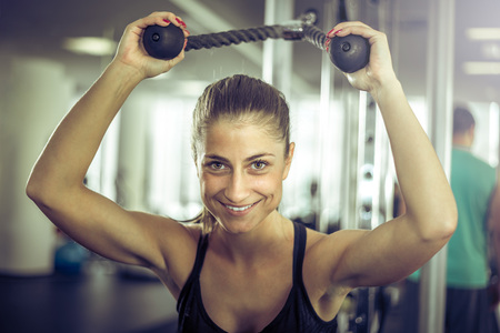 tricep: Girl doing overhead rope extension