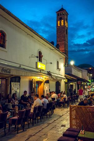 street life: SARAJEVO, BOSNIA AND HERZEGOVINA - JUNE 30, 2016: Street life of Sarajevo, Bosnia during holy muslim month of Ramadan in Evening. Toned image.