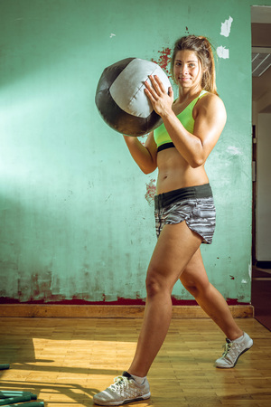 girl working out: Girl working out with medicine ball in gym
