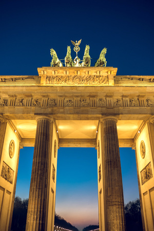 Berlin, Germany - January 22, 2017 -  Brandenburg gate in Berlin, Germany during winter evening. Toned image.