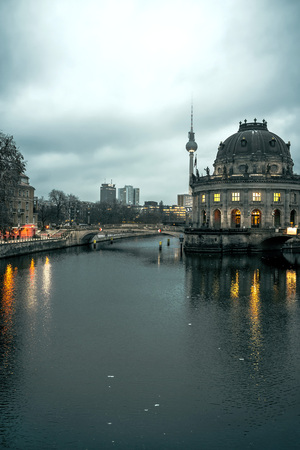 bode: View at Bode museum on Museum Island at Spree river in Berlin, Germany during Winter. TV Tower in background. Toned image.