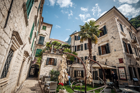 kotor: Kotor, Montenegro - MAY 1, 2017: Exterior view of one small private luxury hotel in narrow streets of Kotor, Montenegro. Toned image.