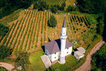 Aerial drone view of masjid  in Bosnian village of  Mracaj, Begov Han in Zepce municipality. Bosnia and Herzegovina. Toned image. Stock Photo