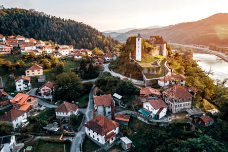 bosna and herzegovina: Aerial view of Maglaj old town in Bosnia with fortress on hill. Toned image.