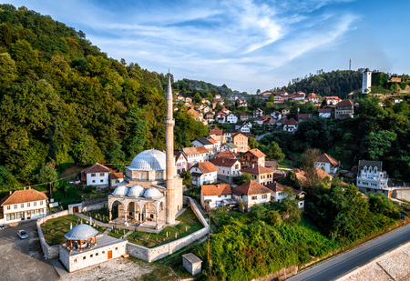 bosna and herzegovina: Jusuf Pasha Kursumlija mosque and old town of Maglaj in Bosnia and Herzegovina. Aerial view. Toned image.