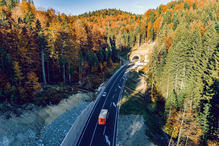Aerial drone view of mountain overpass and modern road with tunnel Karaula in Bosnia and Herzegovina. Connection between Sarajevo and Tuzla. Toned image. Stock Photo