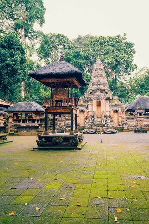 Monkey temple with hindu sculptures in Monkey forest. Ubud, Bali, Indonesia. Stock Photo