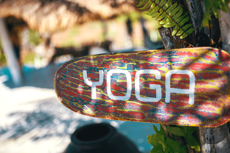 Wooden yoga sign on Bali, Indonesia. Stock Photo