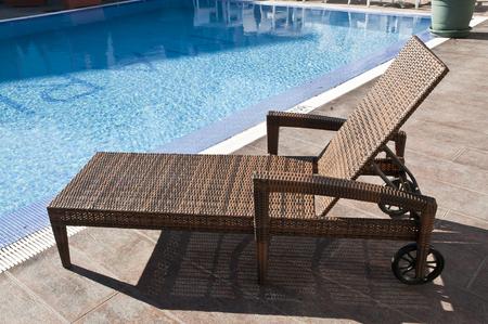 rattan sun lounger with wheels Reklamní fotografie