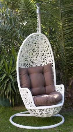 white wicker hanging egg chair Stock Photo
