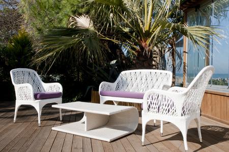 patio outdoor furniture in garden Stock Photo