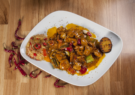 chicken fajitas on white serving plate with garniture. Red hot chili peppers and other colorful vegetables. Stok Fotoğraf
