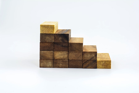 Construction from wooden cubes  It is isolated on a white background  photo