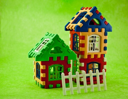 toys like a house on a green background photo