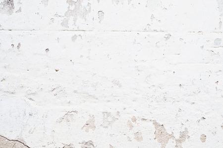 breakaway: white old brick wall with breakaway plaster