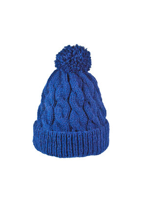 isolated on yellow: winter soft warm blue knitted hat with braids patterns handmade isolated Stock Photo