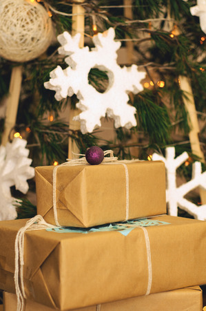 Christmas gifts under the tree ecological style Stock Photo