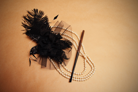 retro hair ornament from feathers necklace and a tube for cigarettes
