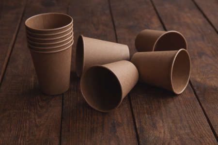ecological kraft paper cups for coffee and tea dark brown on the table
