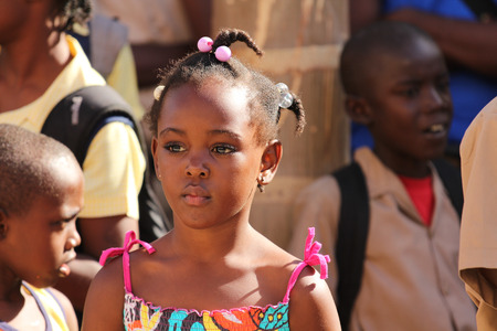 jamaican ethnicity: FALMOUTH, JAMAICA � MAY 11: An unidentified girl outside the port of Falmouth on MAY 11, 2011 in Jamaica ahead of the national labor day celebrations.