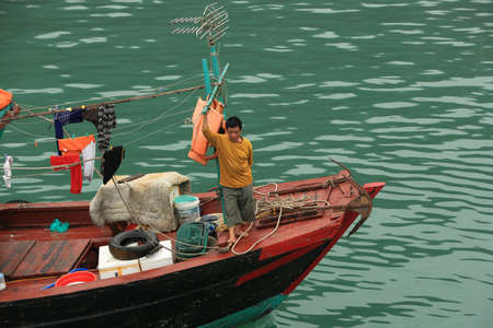 Halong Bay, Vietnam � April 10 2014: Fishing boat in Halong Bay used predominantly to supply the local floating villages. Halong Bay is a UNESCO World Heritage Site and it is one of the prime travel destinations in Vietnam.