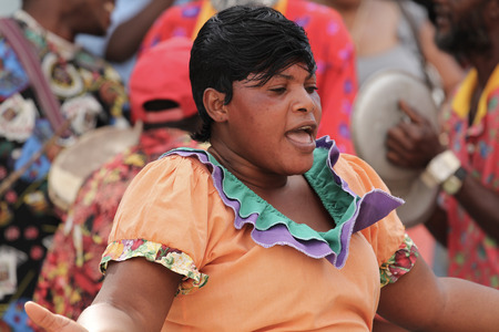 jamaican ethnicity: FALMOUTH, JAMAICA � MAY 11: An unidentified street performer dancing outside the port of Falmouth on MAY 11, 2011 in Jamaica ahead of the national labor day celebrations.