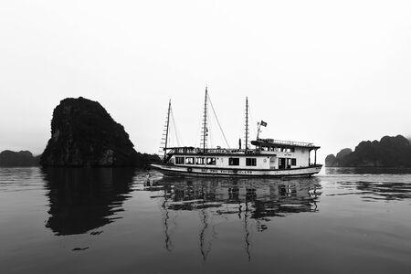 Halong Bay, Vietnam, April 10, 2014  Junk boat in Halong Bay used predominantly as tourist sight-seeing boats  Halong Bay is a UNESCO World Heritage Site and it is one of the prime travel destinations in Vietnam