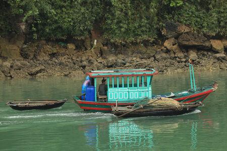 predominantly: Halong Bay, Vietnam - April 10 2014: Fishing boat in Halong Bay used predominantly to supply the local floating villages. Editorial