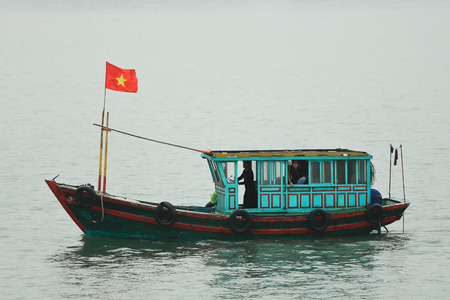 Halong Bay, Vietnam - April 10 2014: Fishing boat in Halong Bay used predominantly to supply the local floating villages.