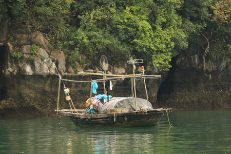 local supply: Fishing boat in Halong Bay used predominantly to supply the local floating villages. Stock Photo