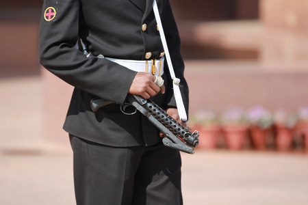bullet proof: New Delhi, India - February 25, 2012: Armed security guard at The India Gate in New Delhi, National Capital Region, North India.