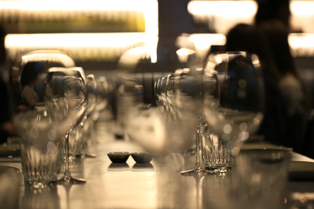 Wine glasses defocused in bar and restaurant and blurred background Banco de Imagens