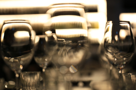 Wine glasses defocused in bar and restaurant and blurred background photo