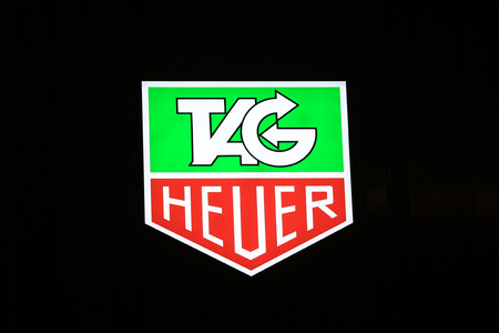 SYDNEY, AUSTRALIA – SEPTEMBER 13, 2014: Tag,Heuer illuminated sign at night in Sydney's CBD shopping district, an area synonymous with luxury shopping brands.