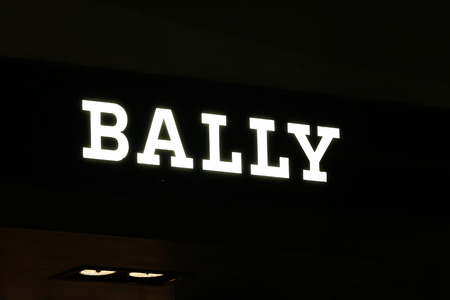synonymous: SYDNEY, AUSTRALIA – SEPTEMBER 13, 2014: Bally illuminated sign at night in Sydney's CBD shopping district, an area synonymous with luxury shopping brands.
