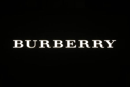 synonymous: SYDNEY, AUSTRALIA – SEPTEMBER 13, 2014: Burberry illuminated sign at night in Sydney's CBD shopping district, an area synonymous with luxury shopping brands.