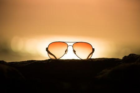 Sunglasses at Sunset Stock Photo