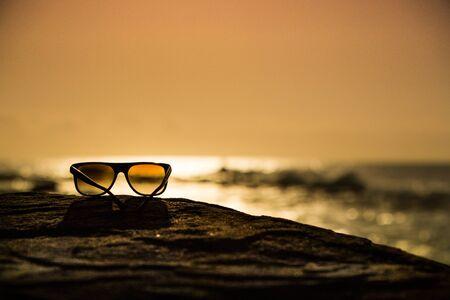sunnies: Sunglasses at Sunset Stock Photo
