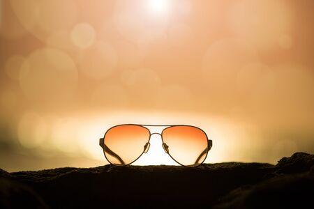Sunglasses at Sunset and Blurred and Defocused Horizon