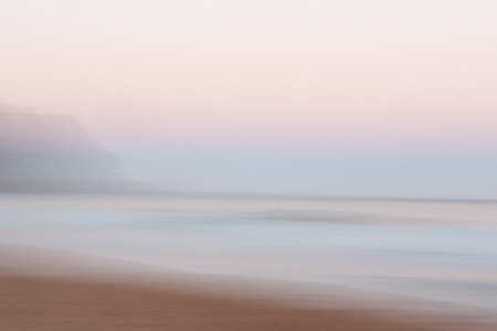 Abstract sunrise ocean with sky background with blurred panning motion causing soft feel