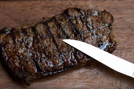 Char-Grilled Steak served on Wooden Board