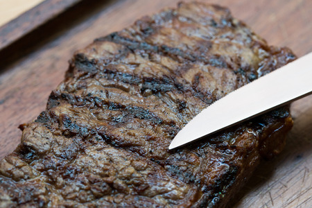 chargrill: Char-Grilled Steak served on Wooden Board
