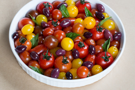 extra virgin olive oil: Rustic Heirloom Cherry Tomato Salad with Basil and Olives in Extra Virgin Olive Oil Stock Photo