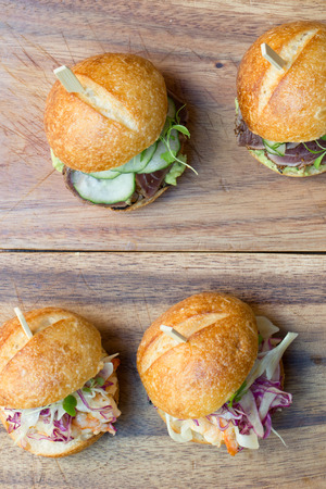 Hamburger sliders with Shrimp on a rustic cutting wooden board
