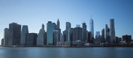 Manhattan financial district with skyscrapers over East River in New York City