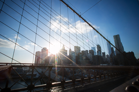 Skyline of downtown New York, Brooklyn Bridge and Manhattan in the afternoon sun light , New York City, USA Banco de Imagens