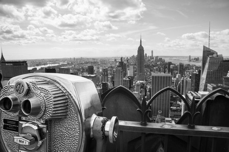 View of Midtown Manhattan New York City with coin-operated telescope at the Top of the Rock
