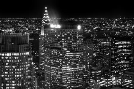 NEW YORK - SEPTEMBER 26 2016: Metlife Building in New York City in the night taken from Rockefeller Center showing Chrysler Building in background, Manhattan, September 26 2016.