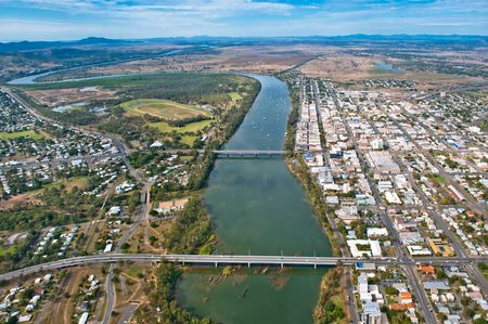 fitzroy: Aerial of Rockhampton, Queensland, Australia looking south from the Neville Hewitt Bridge. This aerial looks up the Fitzroy River and shows the CBD, Callaghan Park, North Rockhampton Bowls Club